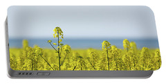 Portable Battery Charger featuring the photograph Canola Field Closeup by Kennerth and Birgitta Kullman