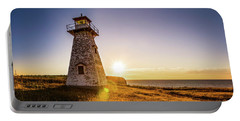 Portable Battery Charger featuring the photograph Cape Tryon Light Sunset by Chris Bordeleau