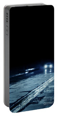 Car On A Rainy Highway At Night Portable Battery Charger by Jill Battaglia