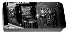 Portable Battery Charger featuring the photograph Cast Iron Character by Greg Fortier