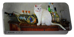 Portable Battery Charger featuring the photograph Cat On The Liquor Cabinet by John Kolenberg