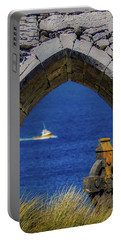Portable Battery Charger featuring the photograph Celtic Cross And Fishing Vessel From Isle Of Inisheer by James Truett