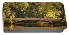 Portable Battery Charger featuring the photograph Central Park Bridge by Francisco Gomez