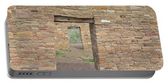 Portable Battery Charger featuring the photograph Chaco Canyon Doors by Debby Pueschel