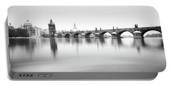 Charles Bridge During Winter Time With Frozen River, Prague, Czech Republic Portable Battery Charger