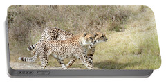Portable Battery Charger featuring the photograph Cheetah Trot 2 by Fraida Gutovich