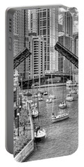 Portable Battery Charger featuring the photograph Chicago River Boat Migration In Black And White by Christopher Arndt