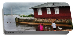 Children Playing At Harbor Essex Ct Portable Battery Charger by Susan Savad