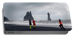 Portable Battery Charger featuring the photograph China's Tourists In Reynisfjara Black Sand Beach, Iceland by Dubi Roman