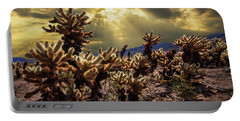 Portable Battery Charger featuring the photograph Cholla Cactus Garden Bathed In Sunlight In Joshua Tree National Park by Randall Nyhof