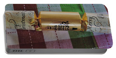 Portable Battery Charger featuring the photograph Christmas Cracker by Cassandra Buckley