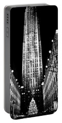 Christmas In New York City Portable Battery Charger by Carol F Austin