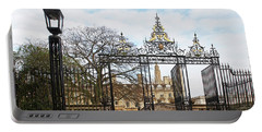 Portable Battery Charger featuring the photograph Clare College Gate Cambridge by Gill Billington