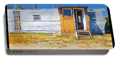Portable Battery Charger featuring the photograph Classic Trailer by Susan Kinney