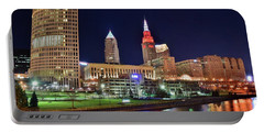Portable Battery Charger featuring the photograph Cle Over The Cuyahoga by Frozen in Time Fine Art Photography
