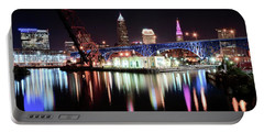 Portable Battery Charger featuring the photograph Cleveland Ohio Lights Up With Color by Frozen in Time Fine Art Photography