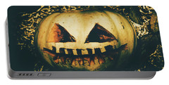Closeup Of Halloween Pumpkin With Scary Face Portable Battery Charger