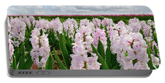 Clouds Over The Pink Hyacinth Field Portable Battery Charger by Mihaela Pater