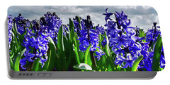 Clouds Over The Purple Hyacinth Field Portable Battery Charger by Mihaela Pater