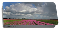 Clouds Over The Purple Tulip Field Portable Battery Charger by Mihaela Pater