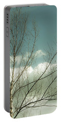 Cloudy Blue Sky Through Tree Top No 1 Portable Battery Charger by Ben and Raisa Gertsberg