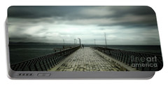 Portable Battery Charger featuring the photograph Cloudy Pier by Perry Webster