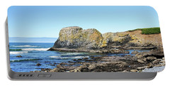 Portable Battery Charger featuring the photograph Cobblestone Beach by Bryan Carter