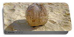 Portable Battery Charger featuring the photograph Coconut In The Sand by Francesca Mackenney