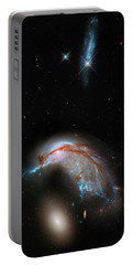 Portable Battery Charger featuring the photograph Colliding Galaxy by Marco Oliveira