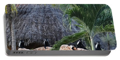 Colobus Monkey Resting On A Wall Portable Battery Charger