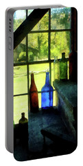 Portable Battery Charger featuring the photograph Colored Bottles On Steps by Susan Savad