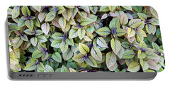 Portable Battery Charger featuring the photograph Colorful Leaves Bush,the Color And Textured Of Nature In Natural by Jingjits Photography