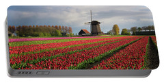 Portable Battery Charger featuring the photograph Colorful Rows Of Tulips In Front Of A Windmill by IPics Photography
