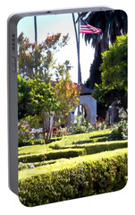 Portable Battery Charger featuring the photograph Colors In The Garden by Glenn McCarthy Art and Photography