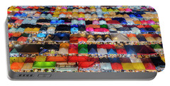 Portable Battery Charger featuring the photograph Colourful Night Market by Pradeep Raja Prints