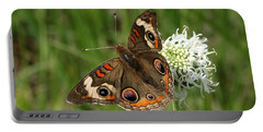 Common Buckeye Butterfly On Wildflower Portable Battery Charger by Sheila Brown