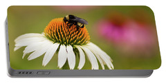 Portable Battery Charger featuring the photograph Coneflower And Bee by Phyllis Peterson