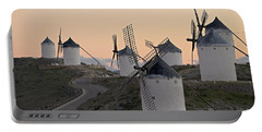 Portable Battery Charger featuring the photograph Consuegra Windmills by Heiko Koehrer-Wagner