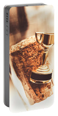 Cork And Trophy Floating In Champagne Flute Portable Battery Charger