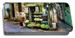 Corner Fresh Veggies Vietnam  Portable Battery Charger by Chuck Kuhn