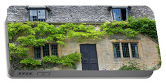 Portable Battery Charger featuring the photograph Cotswolds Cottage Home II by Brian Jannsen
