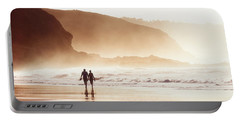 Couple Walking On Beach With Fog Portable Battery Charger