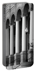 Portable Battery Charger featuring the photograph Courthouse Columns by Richard Rizzo