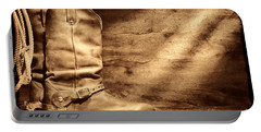 Cowboy Boots On Wood Floor Portable Battery Charger