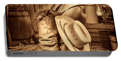 Cowboy Gear In Barn Portable Battery Charger