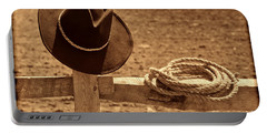 Cowboy Hat And Rope On A Fence Portable Battery Charger