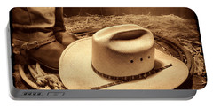 Cowboy Hat On Barn Floor Portable Battery Charger