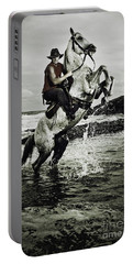 Cowboy On The Rear Up Horse In The River Portable Battery Charger