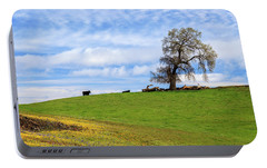 Portable Battery Charger featuring the photograph Cows On A Spring Hill by James Eddy
