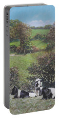 Portable Battery Charger featuring the painting Cows Sitting By Hill Relaxing by Martin Davey